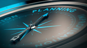 Planning. Compass with needle pointing the word planning, concept image to illustrate business plan and strategy Royalty Free Stock Photos