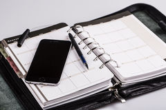 Planning concept - calendar, cellphone, pen Royalty Free Stock Image