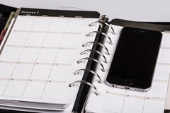 Planning concept - calendar, cellphone Royalty Free Stock Photo
