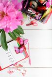 Planning concept for girl or woman with pink and red stationary. With copy space over white wooden table Stock Image