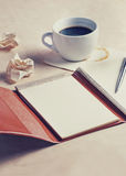 Planning concept, old diary with coffee and pen, vintage filtered Stock Image