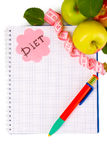 Planning of diet. Notebook, pencil and apples Stock Photos
