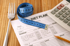 Planning of diet. Diet plan, calculator and fork on the table Royalty Free Stock Image