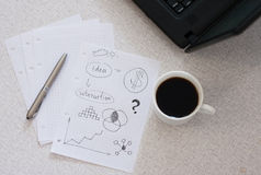 Planning. A financial plan at coffee break royalty free stock image