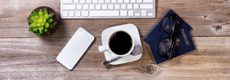 Planning future travel with coffee and other office equipment on Royalty Free Stock Images