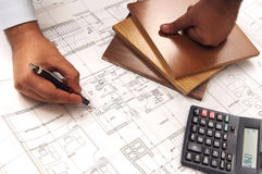 Planning hand. On the blueprints Stock Photography