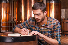Planning his beer business. Stock Photography