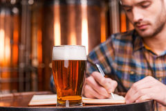 Planning his beer business. Stock Images