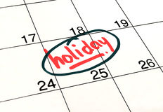 Planning holiday calendar. Marked and written holiday in a calendar to remind you an important appointment stock photo