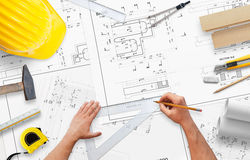 Planning house construction. Work desk with accessories for architects and workers Royalty Free Stock Photos