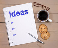 Planning Ideas with Coffee and Cookies Royalty Free Stock Image