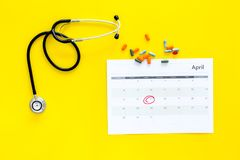 Planning medical examination concept. Regular medical examinations. Calendar with date circled, pills and stethoscope on. Planning medical examination concept Royalty Free Stock Photo