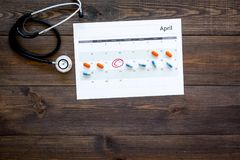 Planning medical examination concept. Regular medical examinations. Calendar with date circled, pills and stethoscope on. Planning medical examination concept Stock Image