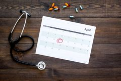 Planning medical examination concept. Regular medical examinations. Calendar with date circled, pills and stethoscope on. Planning medical examination concept Royalty Free Stock Image