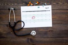 Planning medical examination concept. Regular medical examinations. Calendar with date circled, pills and stethoscope on. Planning medical examination concept Royalty Free Stock Images