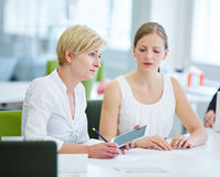 Planning in meeting with pen and tablet computer Stock Photo