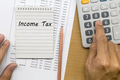 Planning monthly income tax Stock Image