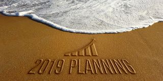 2019 Planning New Year Motivation. Photo Image. Text on sand with Graph Bar for New Year goals royalty free stock photography