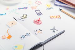 Planning Organizer with icons of actions and target with pushpin as an arrow on the working place with stationery. Creative concep. T of day planning, goals Royalty Free Stock Photo