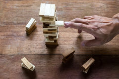 Planning, risk and strategy in business, businessman and enginee. R gambling placing wooden block on a tower Royalty Free Stock Photography