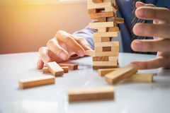 Planning, risk and strategy in business, businessman gambling pl Royalty Free Stock Image