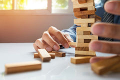 Planning, risk and strategy in business, businessman gambling pl. Acing wooden block on a tower Royalty Free Stock Photography