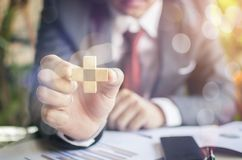 Planning, risk and strategy in business. Closeup of businessman making a pyramid with empty wooden cubes Royalty Free Stock Photo