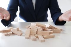 Planning risk and strategy in business, gambling failure of wooden blocks stag. Business concept for growth and success process royalty free stock images