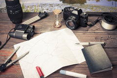 Planning road trip. Table with fishing and photography items Royalty Free Stock Image