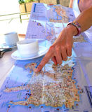 Planning for Roadtrip. Laying out the plan for the road trip during the morning coffee Stock Photography