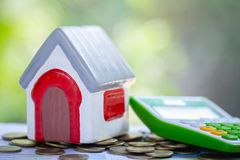 Planning savings money of coins to buy a home, concept for property ladder, mortgage and real estate investment. for saving or stock images