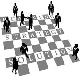 Planning Strategy Solution human chess people. Business people as human chess or checkers pieces on board of Planning Strategy and Solution Stock Image