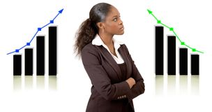 Planning Success. This is an image of a businesswoman in front of two graphs planning for success. This image can be used to represent Planning Successes themes Royalty Free Stock Photos