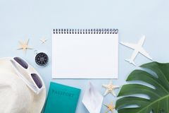 Planning summer holidays, tourism and vacation background. Travelers notebook with accessories on blue table top view. Flat lay. royalty free stock image