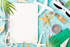 Planning summer holidays, trip, travel and vacation background. Open notebook with accessories on blue table top view. Flat lay. Style royalty free stock images