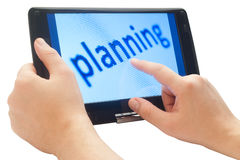 Planning on tablet computer Stock Photo