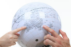 Planning their holiday holding up a globe a Royalty Free Stock Photo