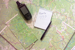 Planning of the travel. GPS reciver on the map. Royalty Free Stock Photos