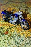 Planning a trip. Motorcycle trip planned with puzzles of map stock photography