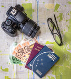Planning a trip - Brazilian and Italian passports on city map with euro bills money, camera and glasses. Planning a trip Brazilian and Italian passports on city Royalty Free Stock Photo