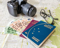 Planning a trip - Brazilian and Italian passports on city map with euro bills money, camera and glasses. Planning a trip Brazilian and Italian passports on city Stock Photos