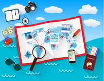 Planning trip concept at table with paper map of world, magnifier, pen, passport, airplane ticket, photo camera photos Stock Images
