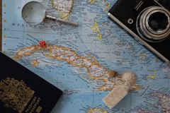 Planning a trip to Cuba on a world map. stock image