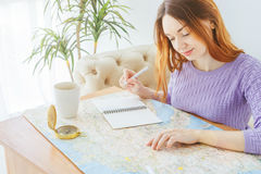 Planning a trip to Europe. Young woman adventurous. royalty free stock photos