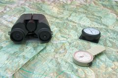 Planning a trip to the mountain. With binoculars, altimeter, pedometer and map Royalty Free Stock Images