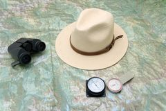 Planning a trip to the mountain. With map, pedometer, altimeter, binoculars and hat Royalty Free Stock Images