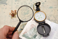 Planning a trip to spain. With a map passport, compass and zoom Royalty Free Stock Photography