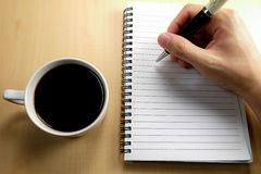 Planning on white notebook Royalty Free Stock Images