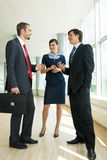 Planning work. Photo of confident businessteam planning work or consulting each other Stock Photos