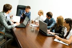 Planning work. Portrait of confident team planning work and interacting with each other at briefing royalty free stock photos